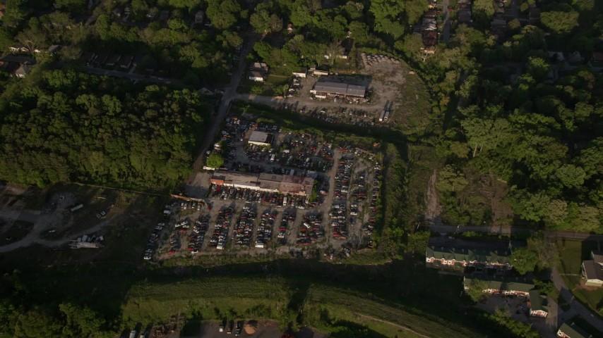 5K stock footage aerial video tilting down on a junkyard, West Atlanta, Georgia Aerial Stock Footage | AX39_001