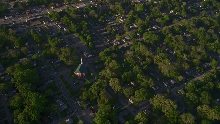 5K stock footage aerial video flying by a church in a residential area, West Atlanta, Georgia Aerial Stock Footage | AX39_002