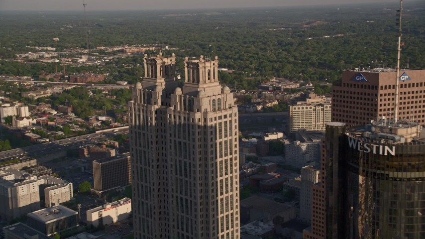 5K aerial video flying by Westin Peachtree Plaza Hotel and 191 Peachtree Tower, Downtown Atlanta Aerial Stock Footage | AX39_005