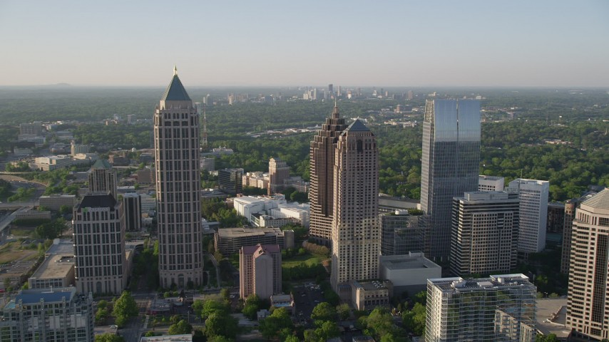 5K stock footage aerial video approaching Midtown Atlanta skyscrapers revealing Promenade II, Georgia Aerial Stock Footage | AX39_023
