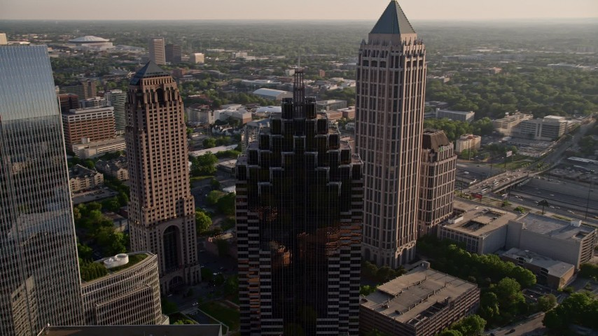 5K stock footage aerial video flying away from Promenade II revealing cluster of skyscrapers, Midtown Atlanta Aerial Stock Footage | AX39_025