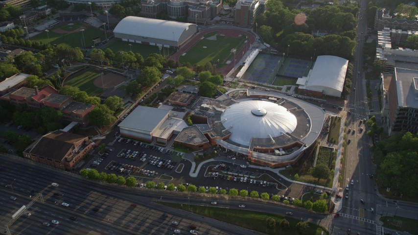 5K stock footage aerial video approaching Alexander Memorial Coliseum and tilting down to a bird's eye shot, Atlanta Aerial Stock Footage | AX39_027