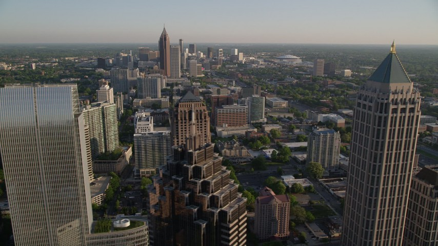 5K aerial video flying away from One Atlantic Center revealing Midtown Atlanta skyscrapers, Georgia Aerial Stock Footage | AX39_032