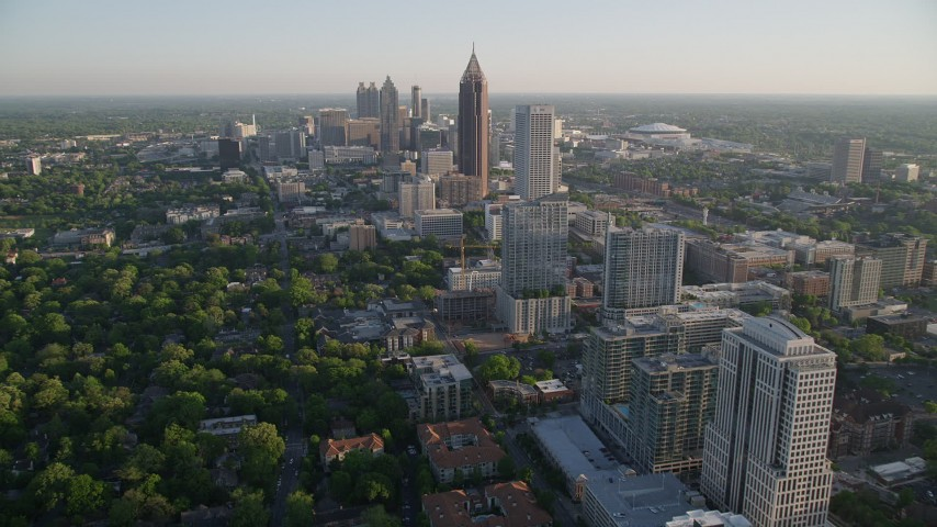 5K stock footage aerial video flying by Midtown Atlanta buildings toward Bank of America Plaza, Georgia Aerial Stock Footage | AX39_034