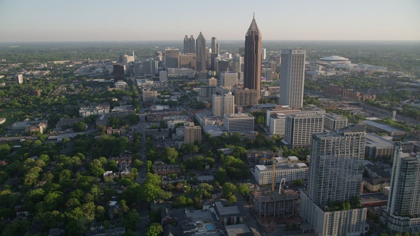 5K aerial video flying by Midtown Atlanta while approaching Bank of America Plaza, Georgia Aerial Stock Footage | AX39_035
