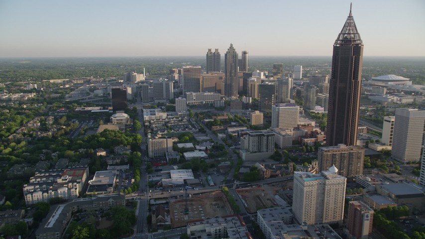 5K stock footage aerial video flying by Bank of America Plaza and approach SunTrust Plaza, Downtown Atlanta Aerial Stock Footage | AX39_036
