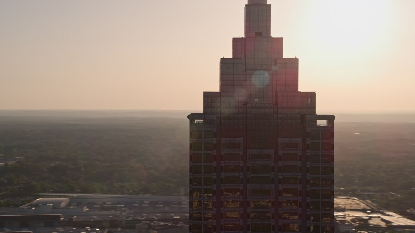 5K aerial video orbiting top of SunTrust Plaza, Downtown Atlanta, sunset Aerial Stock Footage | AX39_038