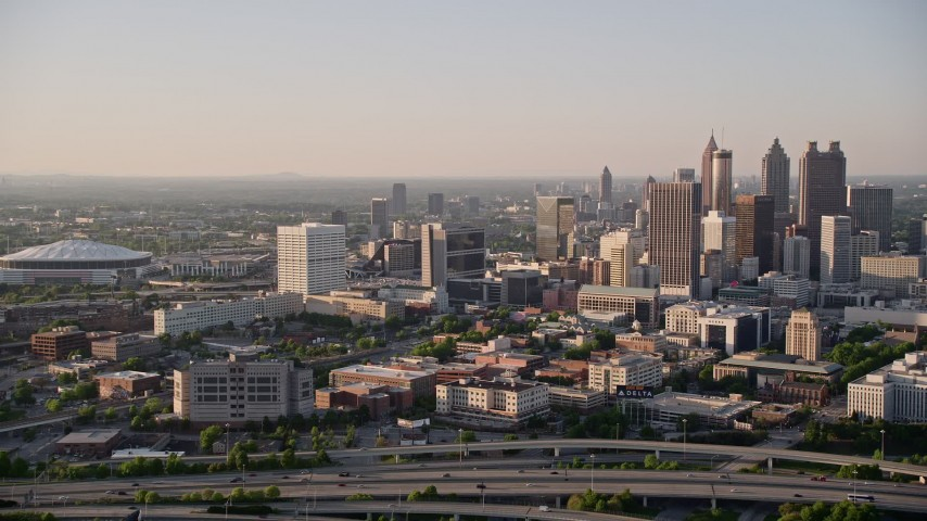 5K stock footage aerial video tilting up from city streets to reveal Downtown Atlanta; Georgia Aerial Stock Footage | AX39_043