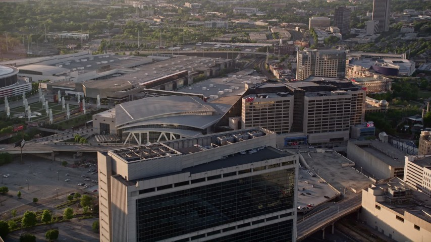 5K aerial video approaching CNN Center and Philips Arena, Downtown Atlanta Aerial Stock Footage | AX39_046
