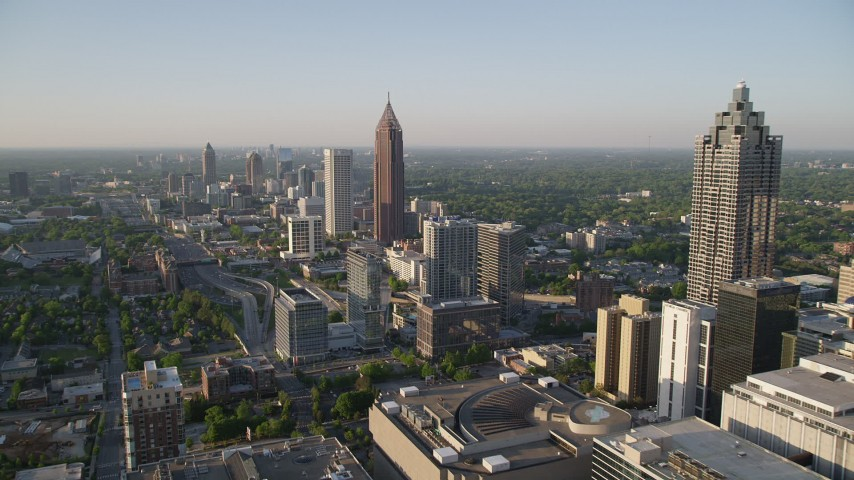 5K stock footage aerial video flying by Midtown Atlanta buildings toward Bank of America Plaza, Georgia Aerial Stock Footage | AX39_048