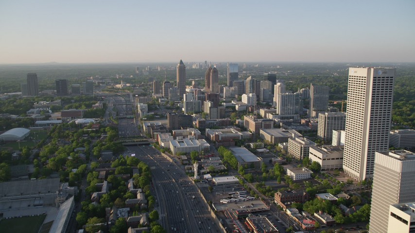 5K stock footage aerial video following Downtown Connector while approaching One Atlantic Center, Midtown Atlanta Aerial Stock Footage | AX39_050