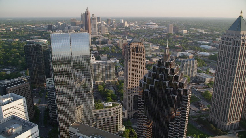 5K stock footage aerial video orbiting away from Promenade II revealing cluster of skyscrapers, Midtown Atlanta Aerial Stock Footage | AX39_058