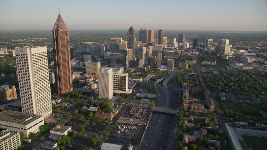 5K stock footage aerial video following Downtown Connector toward Downtown skyscrapers, Atlanta Aerial Stock Footage | AX39_063
