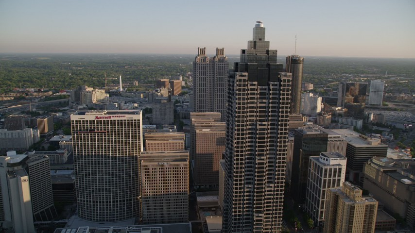 5K stock footage aerial video flying by SunTrust Plaza toward Downtown Atlanta skyscrapers, Georgia Aerial Stock Footage | AX39_065