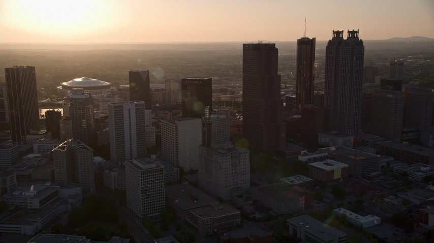 5K aerial video panning across Downtown Atlanta skyscrapers, Georgia, sunset Aerial Stock Footage | AX39_066
