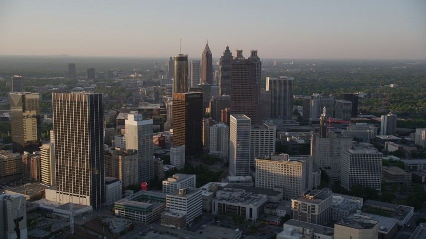 5K stock footage aerial video flying by Downtown Atlanta skyscrapers and high-rises, Georgia, sunset Aerial Stock Footage | AX39_068