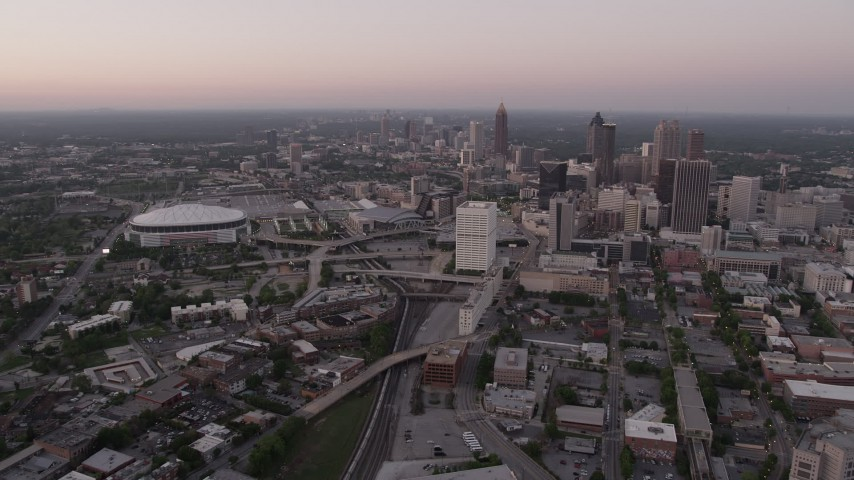 5K aerial video of Midtown and Georgia Dome seen while approaching Downtown, Atlanta, Georgia, twilight Aerial Stock Footage | AX40_002