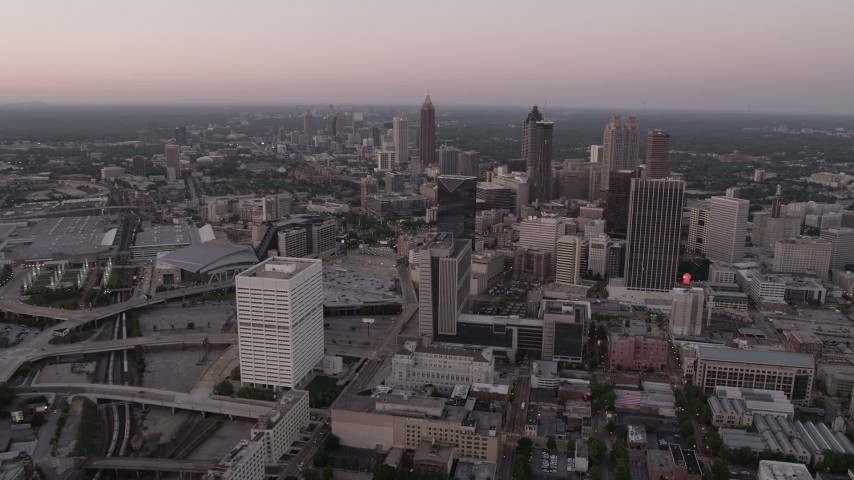 5K aerial video approaching Downtown Atlanta skyscrapers, Georgia, twilight Aerial Stock Footage | AX40_003