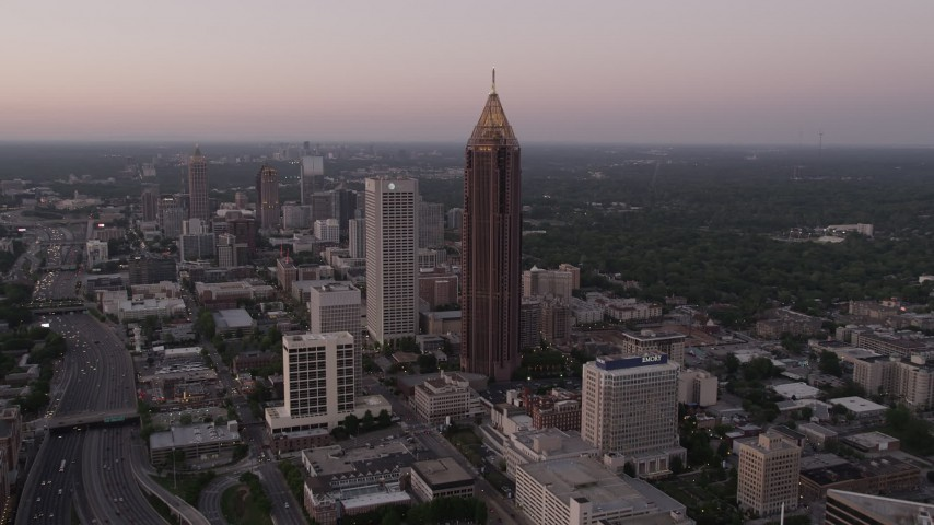 5K stock footage aerial video approaching Bank of America Plaza, Midtown Atlanta, Georgia, twilight Aerial Stock Footage | AX40_006