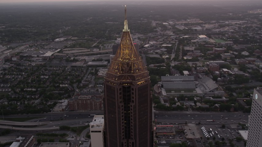 5K stock footage aerial video of a medium shot orbiting Bank of America Plaza, Midtown Atlanta, twilight Aerial Stock Footage | AX40_007