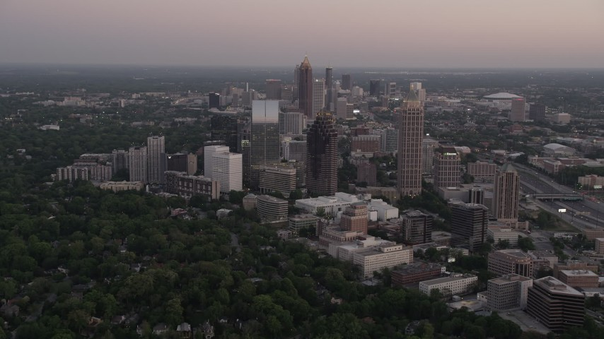5K stock footage aerial video approaching skyscrapers, Midtown Atlanta, Georgia, twilight Aerial Stock Footage | AX40_009