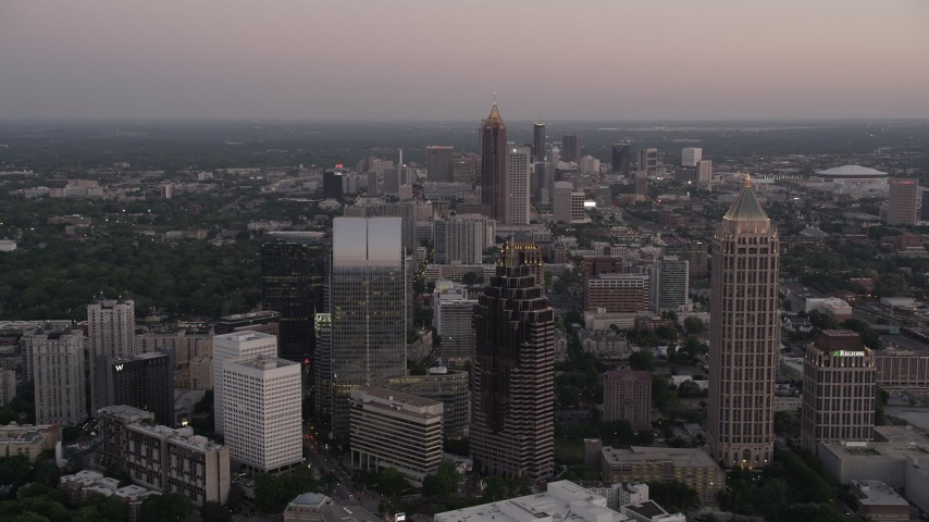 5K aerial video flying over skyscrapers and office buildings, Midtown Atlanta, Georgia, twilight Aerial Stock Footage | AX40_010