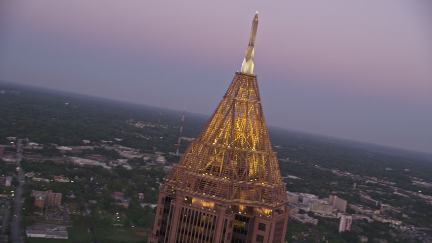 5K aerial video close-up of the top of Bank of America Plaza, Midtown Atlanta, twilight Aerial Stock Footage | AX40_011
