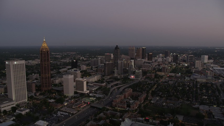5K aerial video approaching Downtown skyscrapers from Midtown, Atlanta, Georgia, sunset Aerial Stock Footage | AX40_012