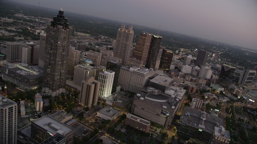 5K stock footage aerial video flying by skyscrapers and office buildings, Downtown Atlanta, sunset Aerial Stock Footage | AX40_014