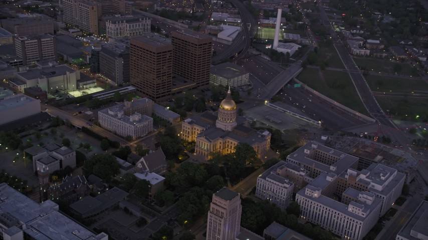 5K aerial video orbiting Georgia State Capitol, Downtown Atlanta, sunset Aerial Stock Footage | AX40_015
