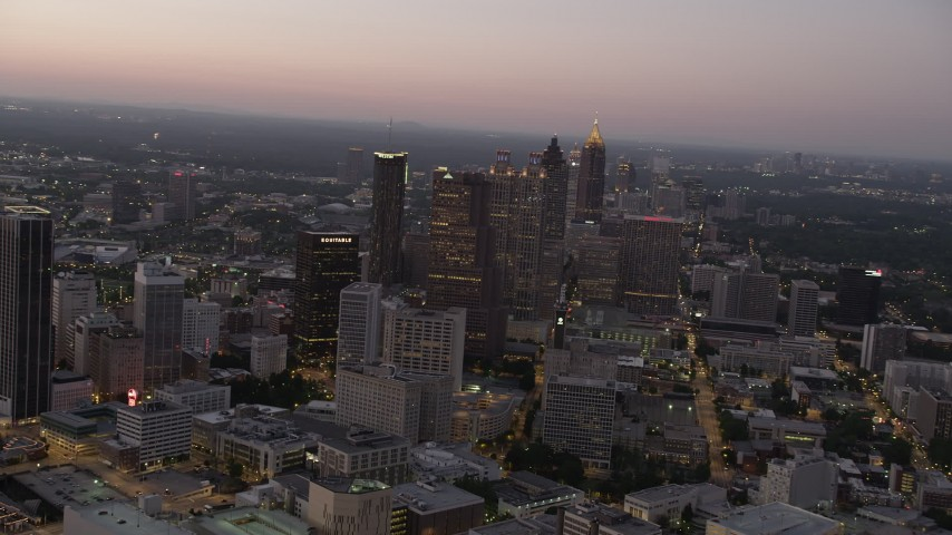 5K stock footage aerial video approaching skyscrapers, Downtown Atlanta, Georgia, sunset Aerial Stock Footage | AX40_016