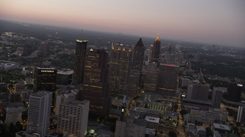 5K stock footage aerial video flying by skyscrapers, Downtown Atlanta, Georgia, sunset Aerial Stock Footage | AX40_017