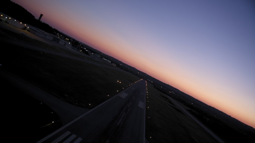 5K stock footage aerial video flying over the runway at Fulton County Airport, Georgia, sunset Aerial Stock Footage AX40_018 | Axiom Images