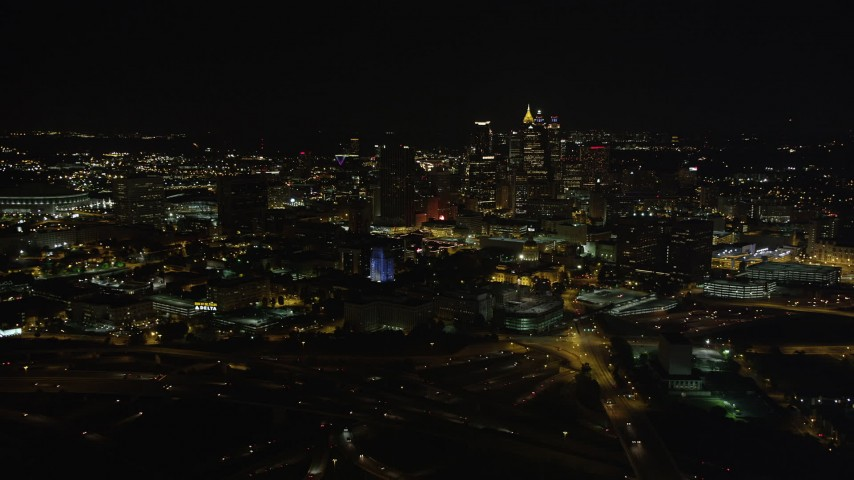 5K stock footage aerial video tilting up to reveal Downtown Atlanta skyline, Atlanta, Georgia, night Aerial Stock Footage | AX41_006