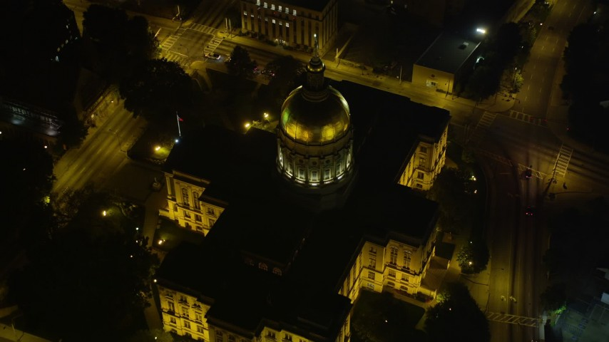 5K stock footage aerial video approaching and tilting down on Georgia State Capitol, Downtown Atlanta, night Aerial Stock Footage | AX41_007