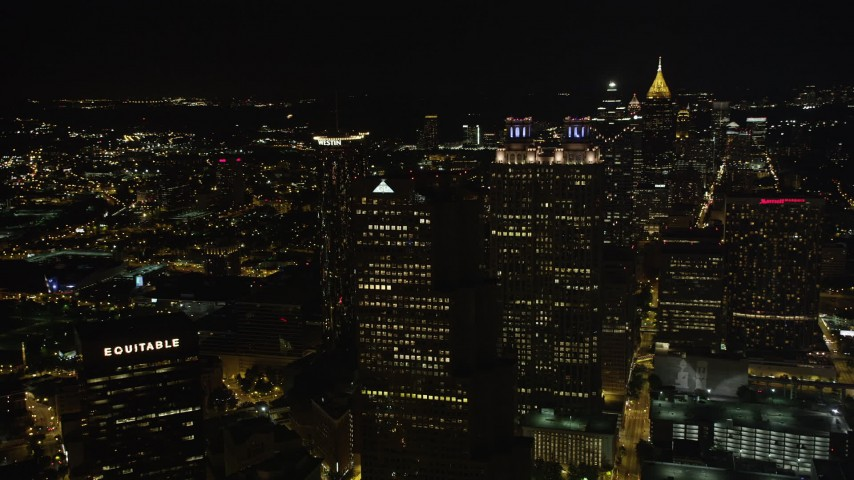 5K stock footage aerial video flying by skyscrapers in Downtown Atlanta, Georgia, night Aerial Stock Footage | AX41_008