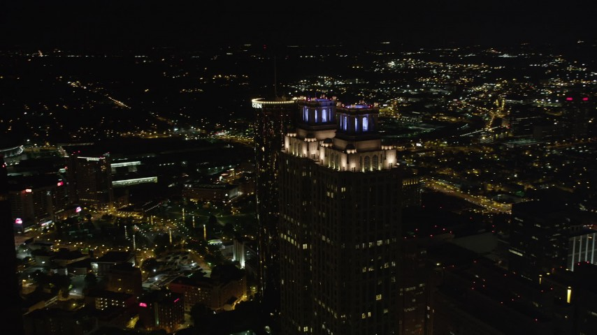 5K stock footage aerial video orbiting 191 Peachtree Tower, Downtown Atlanta, Georgia, night Aerial Stock Footage | AX41_009