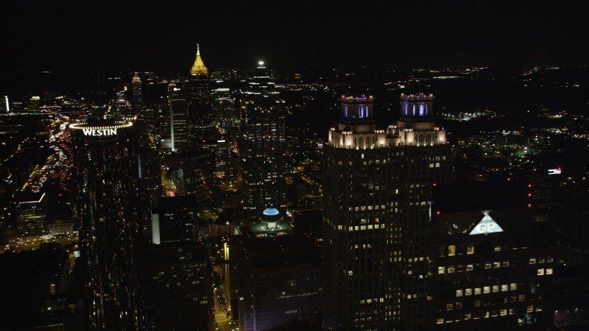 5K stock footage aerial video flying by tops of skyscrapers, Downtown Atlanta, Georgia, night Aerial Stock Footage | AX41_012