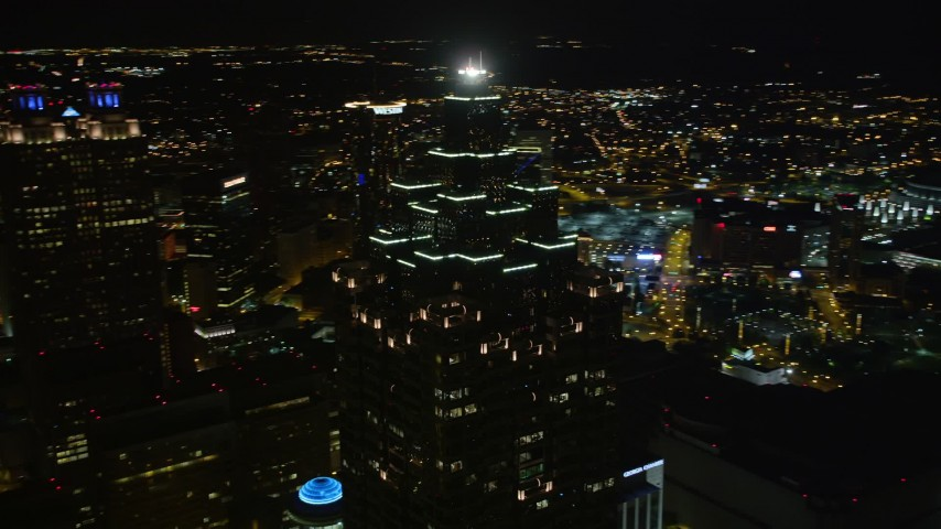 5K stock footage aerial video orbiting SunTrust Plaza, Downtown Atlanta, Georgia, night Aerial Stock Footage | AX41_015