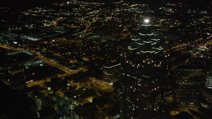 5K stock footage aerial video orbiting away from SunTrust Plaza revealing city lights, Downtown Atlanta, night Aerial Stock Footage | AX41_017
