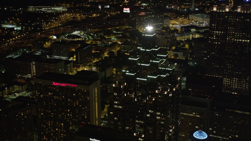 5K stock footage aerial video orbiting SunTrust Plaza, Downtown Atlanta, Georgia, night Aerial Stock Footage | AX41_019