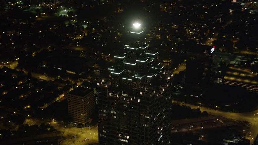 5K aerial video orbiting the top of SunTrust Plaza revealing the lights of the city, Downtown Atlanta, Georgia, night Aerial Stock Footage | AX41_020