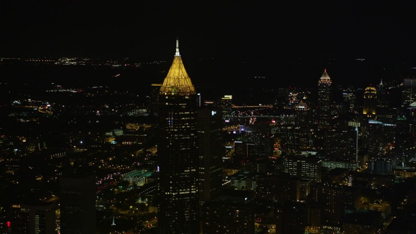 5K stock footage aerial video approaching Bank of America Plaza, Midtown Atlanta, Georgia, night Aerial Stock Footage | AX41_021