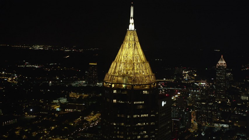 5K stock footage aerial video orbiting top of Bank of America Plaza, Midtown Atlanta, Georgia, night Aerial Stock Footage | AX41_022