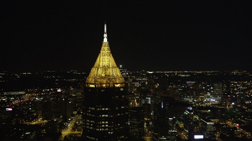 5K aerial video orbiting top of Bank of America Plaza, Midtown Atlanta, Georgia, night Aerial Stock Footage | AX41_024