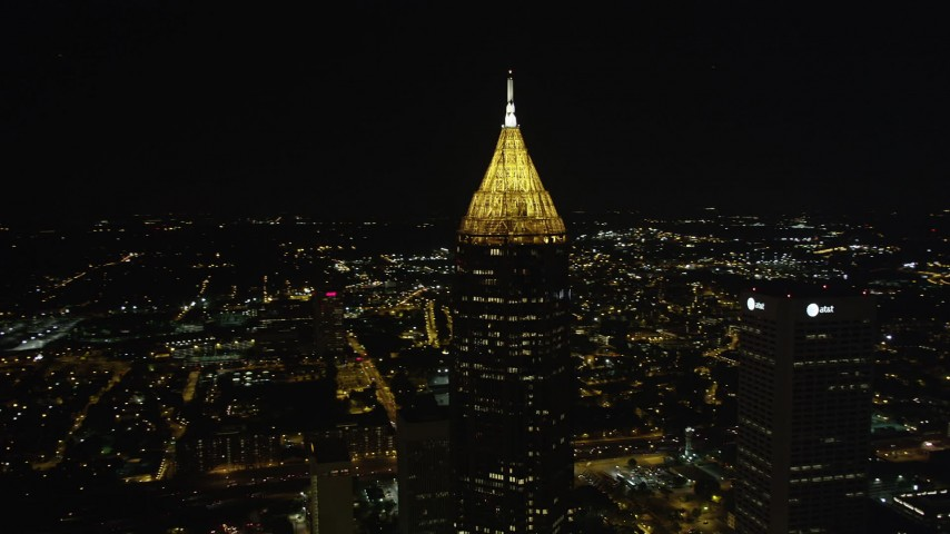 5K stock footage aerial video orbiting Bank of America Plaza revealing skyscrapers, Midtown Atlanta, night Aerial Stock Footage | AX41_025