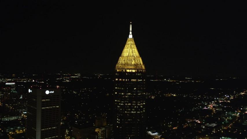 5K stock footage aerial video orbiting top of Bank of America Plaza, Midtown Atlanta, Georgia, night Aerial Stock Footage | AX41_026
