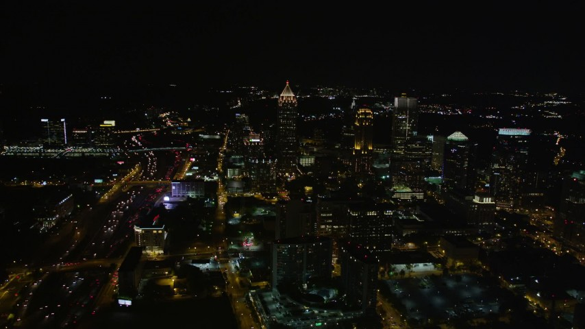 5K aerial video tilting down on condominium complex, Midtown Atlanta, Georgia, night Aerial Stock Footage | AX41_027