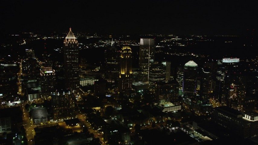 5K stock footage aerial video flying by skyscrapers toward One Atlantic Center, Midtown Atlanta, Georgia, night Aerial Stock Footage | AX41_028