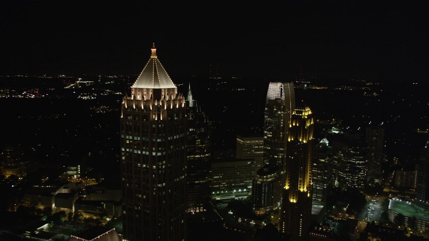 5K aerial video flying by One Atlantic Center revealing skyscrapers, Midtown Atlanta, night Aerial Stock Footage AX41_029